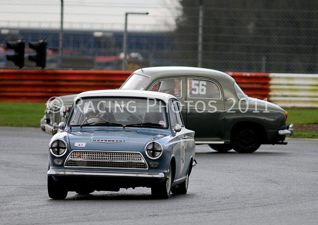 Ford Cortina Mk I with spinning Rover 100 in the background