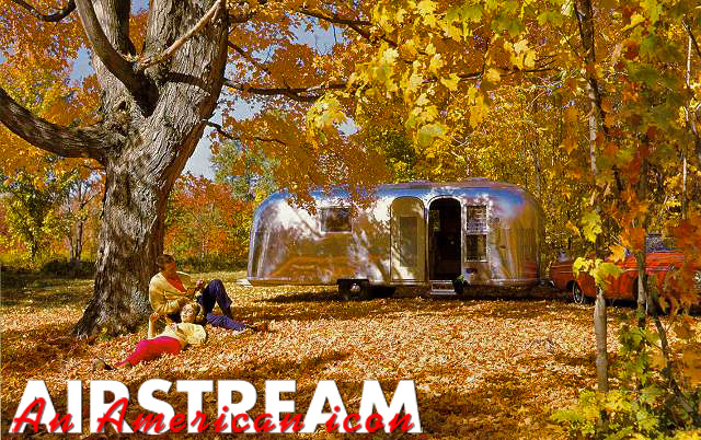 Airstream trailer under autumn trees